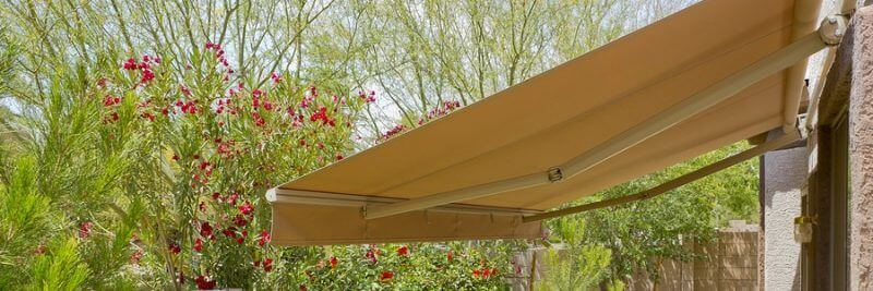 backyard with automatic retractable awning for extra shade