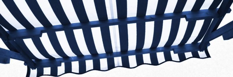 View from shade below blue white striped awning